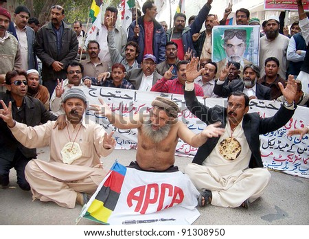 HYDERABAD, PAKISTAN - DEC 21: Members of All Pakistan Clerks Association (APCA) protest in favor of their demands during demonstration on December 21, 2011in Hyderabad. - stock photo