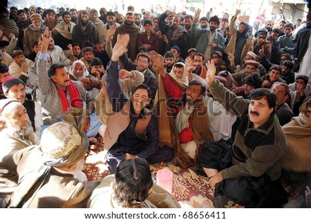 HYDERABAD, PAKISTAN - JAN 09: Supporters of Awami National Party are protesting against killing of a shopkeeper, Saddam Hussain, during demonstration on January 09, 2011in Hyderabad.