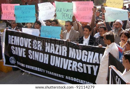 HYDERABAD, PAKISTAN-JAN 06: Supporters of Sindh University Teachers Association are protesting in favor of their demands during demonstration in Hyderabad on Friday, January 06, 2012. - stock photo