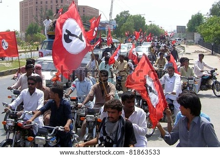 HYDERABAD, PAKISTAN - JUL 28: Supporters of Jeay Sindh Qaumi Mahaz (JSQM) pass through a road during protest rally in favor of their demands on July 28, 2011in Hyderabad, Pakistan.