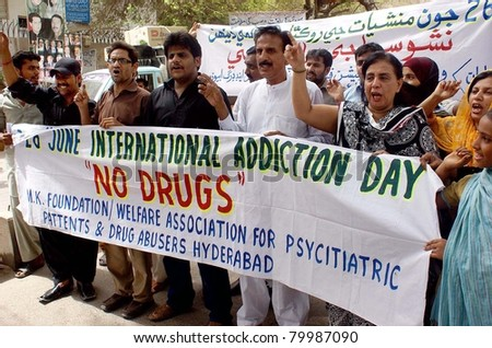 HYDERABAD, PAKISTAN - JUNE 26: Members of Association for Psychiatric Patients and Drug Abusers chant slogans against the use of drugs during a rally on Sunday, June 26, 2011 in Hyderabad, Pakistan.