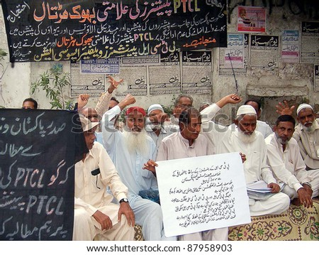 HYDERABAD, PAKISTAN - NOV 02: Telecommunication Company (PTCL) pensioners chant slogans in favor of their demands during demonstration on November 02, 2011in Hyderabad. - stock photo