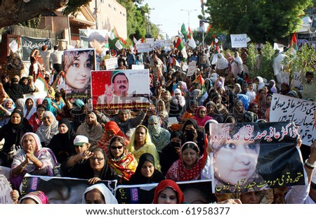 HYDERABAD, PAKISTAN-SEPT 28: Supporters of Muttehda Qaumi Moment (MQM) are protesting for the release of Dr.Aafia Siddiqui during rally on Tuesday, Sept 28, 2010 in Hyderabad.