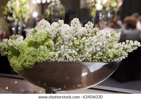 hydrangea and lilac in vase. Decoration of wedding table - stock photo
