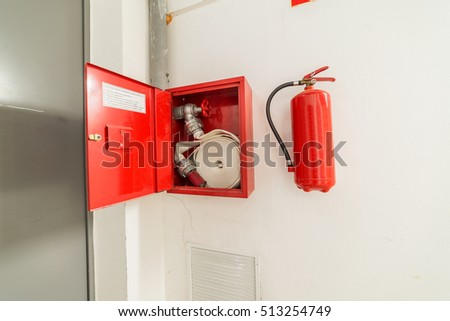 hydrant and fire extinguisher hanging on the wall