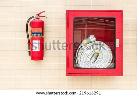 Hydrant with water hoses and fire extinguish equipment. - stock photo
