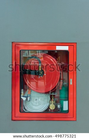 Hydrant with water hoses and fire extinguish equipment, Fire fighter equipment in the red box