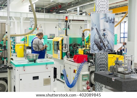 Hydraulic and hybrid injection molding machines and operators during thermoplastics processing and high-end injection molded parts production, Sofia, FESTO Bulgaria, September 11, 2015.