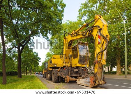 Hydraulic concrete breaker parked on a residential  road. - stock photo