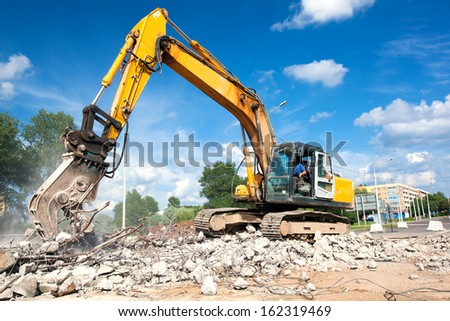 Hydraulic Crusher excavator machine at Site Demolition - stock photo