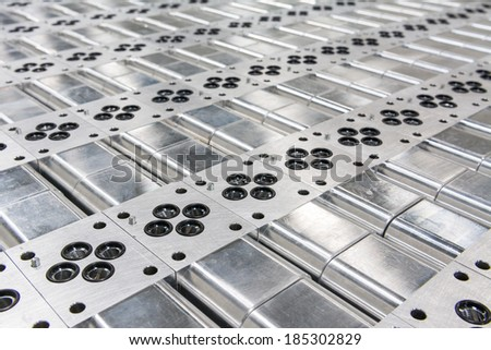 Hydraulic Custom D03 Manifolds Made From Clear Anodized Aluminum - stock photo