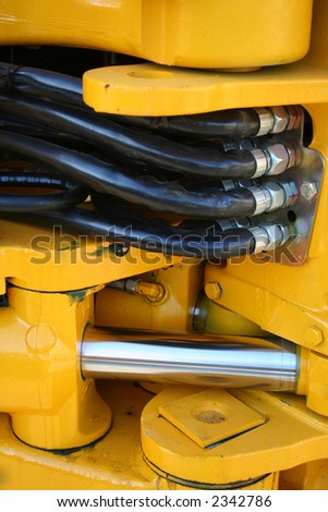 Hydraulic elements of the heavy building bulldozer of yellow color,