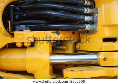 Hydraulic elements of the heavy building bulldozer of yellow color horizontally,