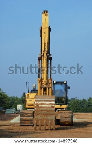 Hydraulic excavator on construction site. - stock photo