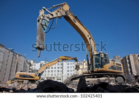 Hydraulic hammer on demolitiom of old buildings - stock photo