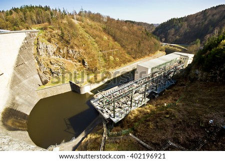 Hydro-electric station. Water power plant. The concrete dam on the river. - stock photo