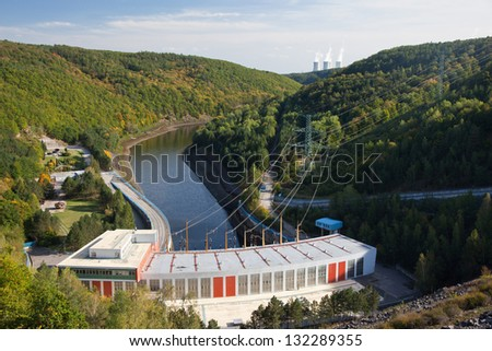 Hydro power plant below the dam - stock photo