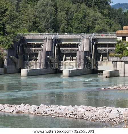 Hydro power plant on Salzach river in Schwarzach im Pongau, Austria. Hydroelectricity solution. - stock photo