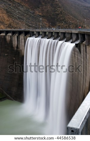 hydro power plant with a waterfall - stock photo