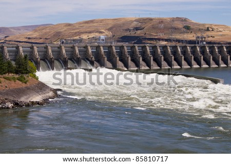 Hydroelectric dam and spillway on the Columbia River at The Dalles Oregon - stock photo
