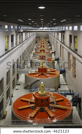 Hydroelectric Generators in a Powerhouse - Renewable Energy Sources infrastructure in one point perspective - stock photo