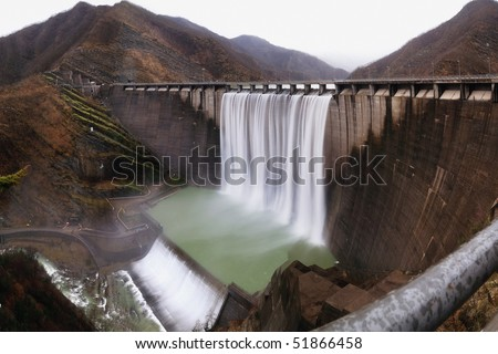 hydroelectric plant on the mountain - stock photo
