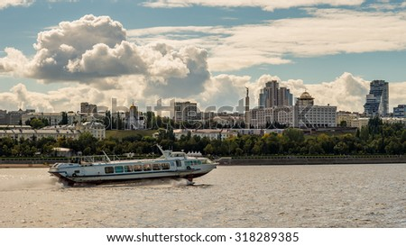 Hydrofoil ship sails in front of beaches of the city of Samara on Volga river, Russia