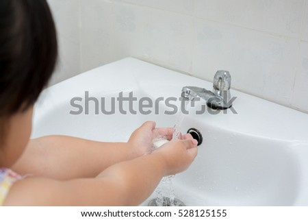 Hygiene.Cleaning Hands,Kid washing of hands with soap under running water.