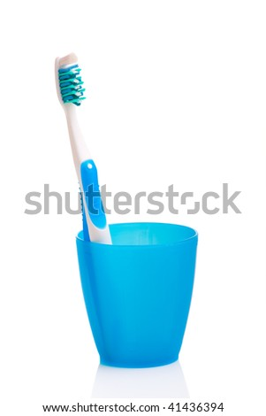 Hygiene objects, toothbrush on a cup isolated on white background