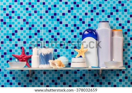 Hygiene products on the shelf in the bathroom - stock photo
