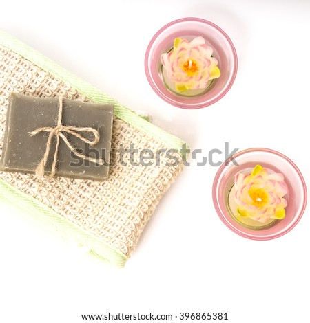 hygiene soap bar with wisp and candles . Spa background. Bath herbal toiletries for beauty, wellness, health. Scented natural cosmetics for body care, clean, wash. Aromatic, aroma freshness - stock photo