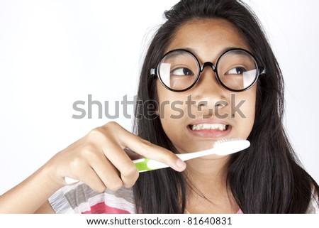 hygiene teenage, Asian girl having toothbrush on her teeth. - stock photo