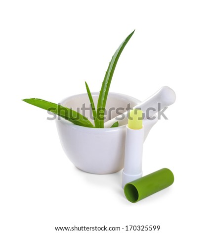 Hygienic lipstick with aloe leaf. Small Depth of Field (DOF)  - stock photo
