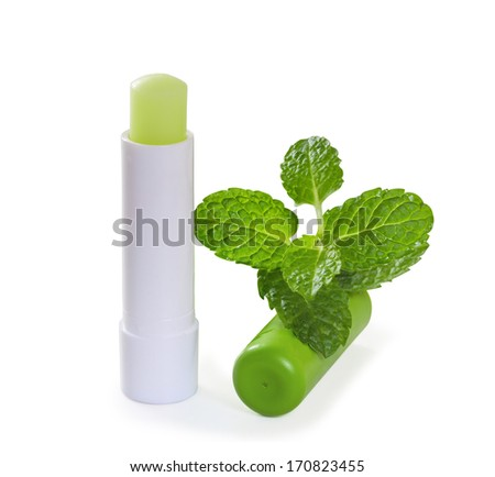 Hygienic lipstick with mint leaves. Isolate on white background