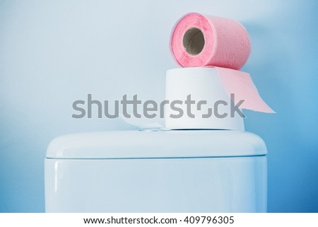 Hygienic paper on white toilet tank closeup - stock photo