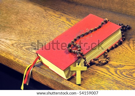 Hymnal  book and wooden rosary bead- detail - stock photo