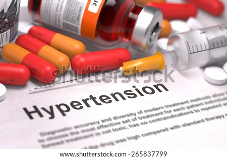 Hypertension- Printed Diagnosis with Blurred Text. On Background of Medicaments Composition - Red Pills, Injections and Syringe. - stock photo