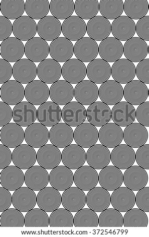 Hypnotic Black and White Circle Pattern is a background design of black and white circles that reduce into each other laid out in a grid pattern.  - stock photo