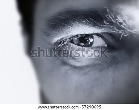 Hypnotic Male eye closeup - stock photo