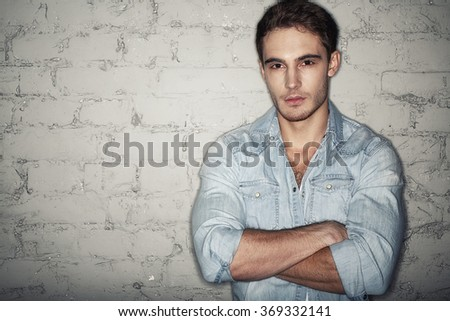 Hypnotizing you. Half length shot of a handsome young man looking to the camera seriously - stock photo