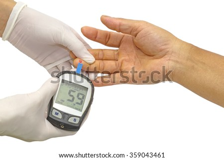 Hypoglycemia ,blood glucose meter, the blood sugar value is measured on a finger by  female doctor in white medical gloves - stock photo