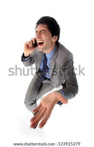 Hysterical businessman on the phone - stock photo