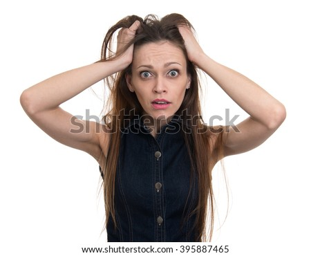 Hysterical woman expression with her hands on the head. Isolated - stock photo