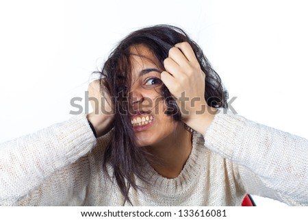 Hysterical woman expression with her hands on the head on a white isolated background