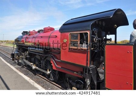 HYTHE, UK - MAY 8, 2016. The 1931 one third scale working steam locomotive on the 15 inch narrow gauge railway completed in 1928 from Hythe to Dungeness in Kent, England, UK. - stock photo