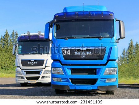 HYVINKAA, FINLAND - JUNE 28, 2014: White and Blue MAN Truck tractor parked. MAN obtains very good results from oekom research and Dow Jones Sustainability Index. - stock photo