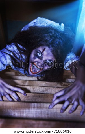 I am creeping to you. Horror Scene. - stock photo