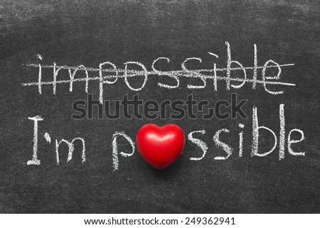I am possible concept handwritten on blackboard with heart symbol instead of O