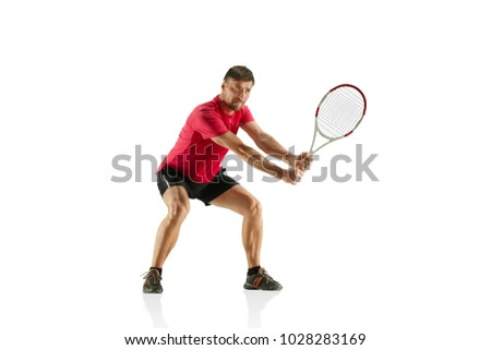 I am saving this ball now. Player lunge, game of defense. The one caucasian fit man playing tennis at studio. Player standing at studio and isolated on white background with racquet. Emotions on face