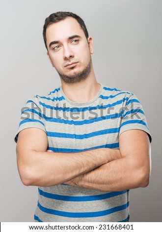 I am so happy! Happy young man gesturing while standing  - stock photo